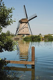 Reflected windmill stock image