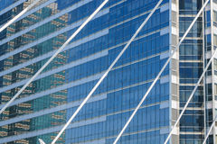 Reflected in windows of modern office building Stock Photography