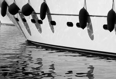 Reflected yacht. The fenders on a yacht in St Tropez reflect in the water of the harbor Royalty Free Stock Image
