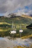 Reflected yachts in Loch Leven Royalty Free Stock Images