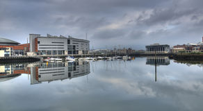Reflecting on Belfast. Early morning reflections of the moorings behind the Odyssey Arena in Belfast Royalty Free Stock Photo