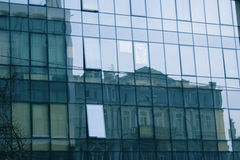 Reflecting in business center mirror windows. Another building with one of the numerous window another angle, Ukrainian capital - Kyiv Stock Photos