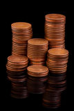 Reflecting coin columns. Money coin columns reflecting in the dark Stock Image