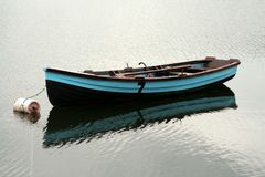 Reflecting Dreams. Fly fising boat sits waiting for fishemen Stock Image