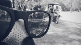 Reflecting glares. A black and white picture of wayfarers in the forest of Angkor wat , Cambodia royalty free stock image