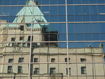 Reflecting on Glory. Hotel Vancouver reflecting off of an office tower in Downtown Vancouver stock photography