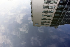 Reflecting houses in water Stock Image