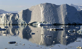 Reflecting iceberg. In the evening sunlight Royalty Free Stock Photography