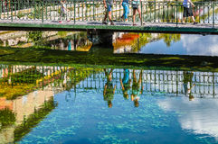 Reflecting people on a river in France. Reflecting people on a riverat Isle Sur la Sorgue in France Royalty Free Stock Photos