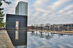 Reflecting Pool and the Gates of Time of the Oklahoma City National Memorial in Oklahoma City, OK. Oklahoma City, Oklahoma, United States of America - January 18 stock photography