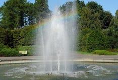 Fountain creates a rainbow. Reflecting pool of water fountain creates a vivid rainbow Royalty Free Stock Image
