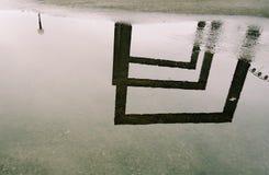 Reflecting puddle Stock Photos