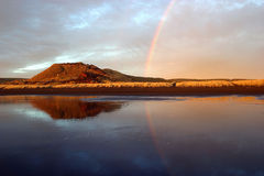 Reflecting Rainbow. New Zealand stock photo