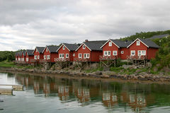 Reflecting rorbuer (cottages). Rorbuer (rorbuer are fisherman huts, which in most of the cases as holiday houses are let) in Stokmarknes at the island Hadseløya Royalty Free Stock Image