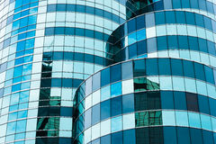 Reflecting sky in glass of office building ; abstract background Royalty Free Stock Photos
