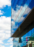 Reflecting sky in glass of office building abstract background Stock Images