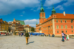 Reflecting surface of fountain and Warsaw, Poland. Houses in the Old Town of Warsaw, Poland Royalty Free Stock Image