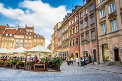 Reflecting surface of fountain and Warsaw, Poland. Warsaw, Poland old town marketplace square and colorful houses Royalty Free Stock Photos