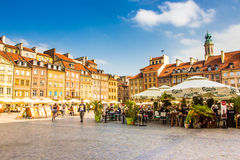 Reflecting surface of fountain and Warsaw, Poland. Warsaw, Poland old town marketplace square and colorful houses Royalty Free Stock Photo
