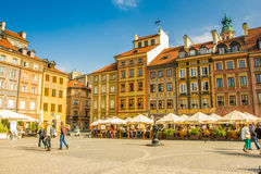 Reflecting surface of fountain and Warsaw, Poland. Warsaw, Poland old town marketplace square and colorful houses Royalty Free Stock Photography