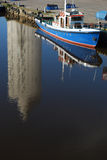 Reflecting tall building from water at small harbo Royalty Free Stock Image