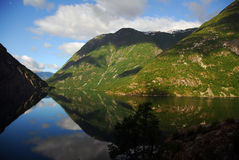 Reflecting Tranquility II. Sky and mountain reflections at a fjord Stock Images