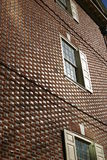 Reflecting wall. Traditional brick wall with sun reflecting of it stock image