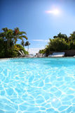 Reflecting water in the swimming pool on a hot sunny day Royalty Free Stock Images