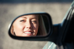Reflection. Young blonde women driver, in the mirror Stock Images