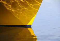 Reflection. Ship\'s hull and its reflection in the water Stock Photography