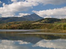 Reflection. Of Choc mountain in Liptovska Mara lake located in Slovakia Royalty Free Stock Photo