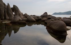 Reflection. Of rocks in sea water.Evenig Royalty Free Stock Images
