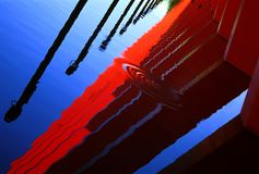 Reflection. Of poles in water of red architectural detail Stock Images