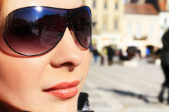 Reflection. Beautiful brunette woman with sunglasses Stock Image