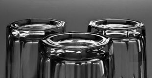 Reflection. Sparkling glasses  on gray background Royalty Free Stock Photo