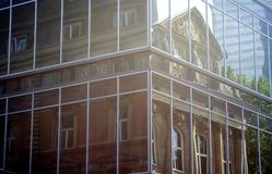 Reflection. Of an old building in the windows of a modern building royalty free stock photo