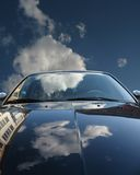 Reflection. Of the sky and a building in a car Stock Photos