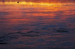 Reflection. Sunset reflected in the sea in Borgarnes, Borgarfjordur, Iceland Stock Images