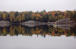 Reflection. Of colorful forest in lake surface in the overcast day Royalty Free Stock Photography