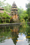 Reflection. Of traditional Bali gate on the pond filled with local goldfish Royalty Free Stock Photography