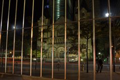 Reflection. View of catolic church on night street of Toronto Stock Images