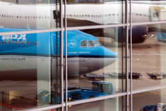 Reflection of the aircrafts in airport windows Stock Photos