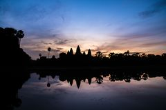 Reflection of an Angkor Wat in silhouette look in Siem Reap, Cam. View of the reflection of an Angkor Wat in silhouette look in Siem Reap, Cambodia stock photo