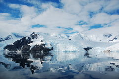 Reflection of  antarctica. Icebergs in Antarctica are reflected on quiet sea Stock Photography