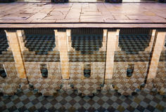 Reflection of Arabic arches in tiled pool Stock Image
