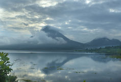 Reflection of Arenal. A beautiful reflection of Arenal Volcano in Costa Rica Stock Photo