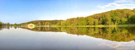Reflection on artificial lake at Herneacova, Romania Royalty Free Stock Photo