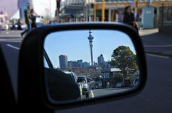Reflection of Auckland skyline on a care mirror Stock Image