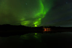Reflection of Aurora Borealis over Olnes pond in Fairbanks, Alaska Royalty Free Stock Photo