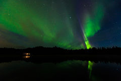 Reflection of Aurora Borealis over Olnes pond in Fairbanks, Alaska Stock Image